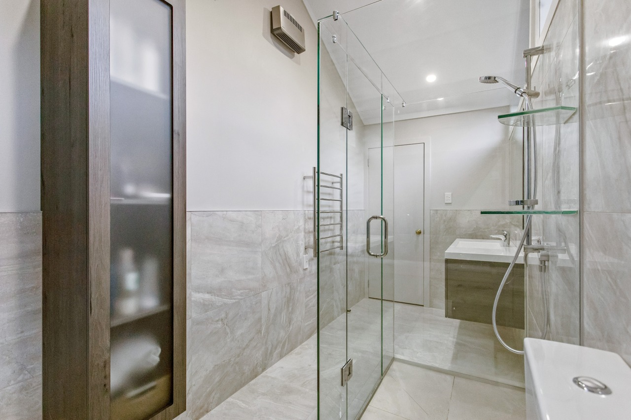 Practical and decorative, the wall-hung translucent glass and architecture, bathroom, building, door, floor, glass, house, interior design, plumbing fixture, property, real estate, room, shower, shower door, tile, gray