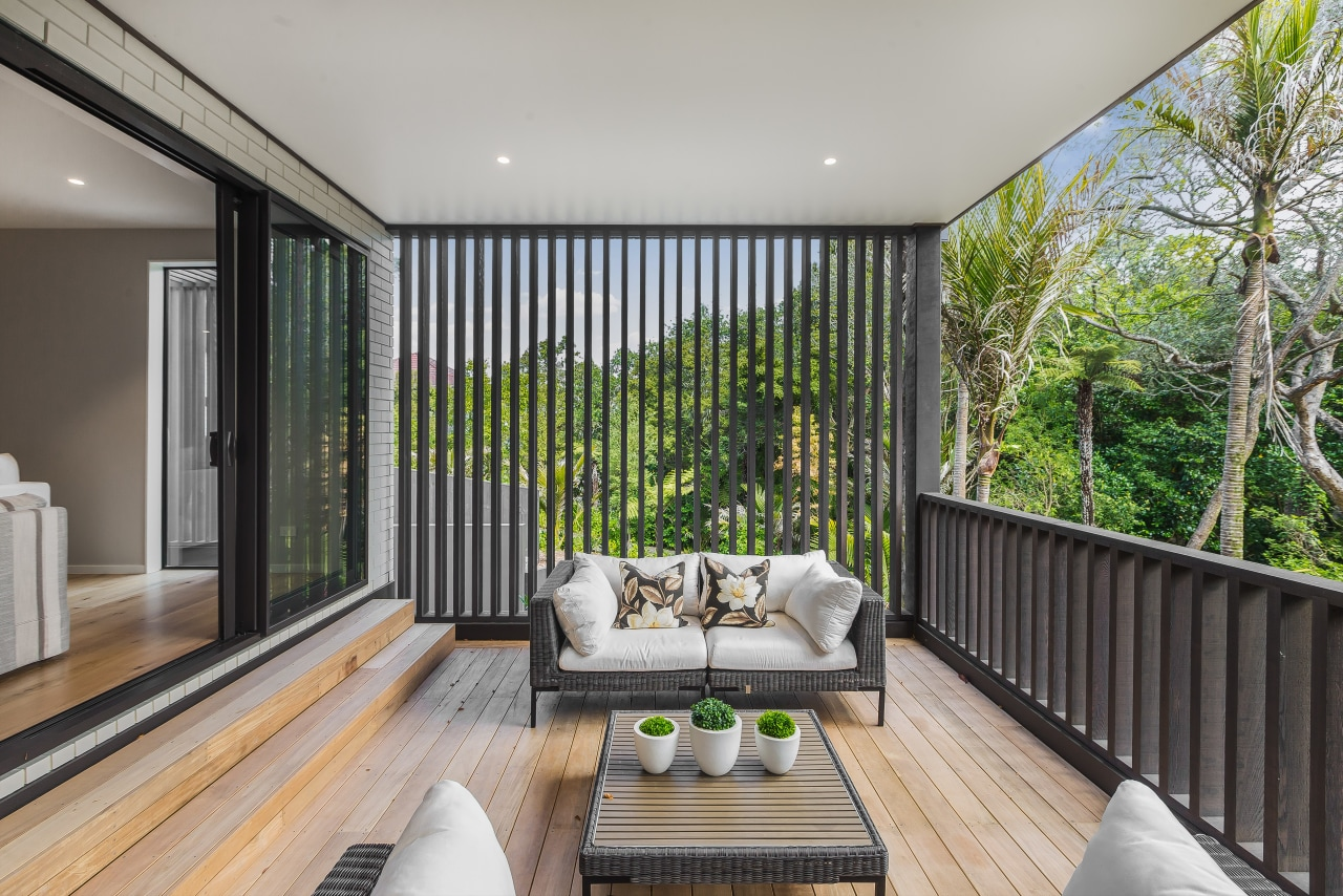 Wrapped in timber-screening, the deck sits above the