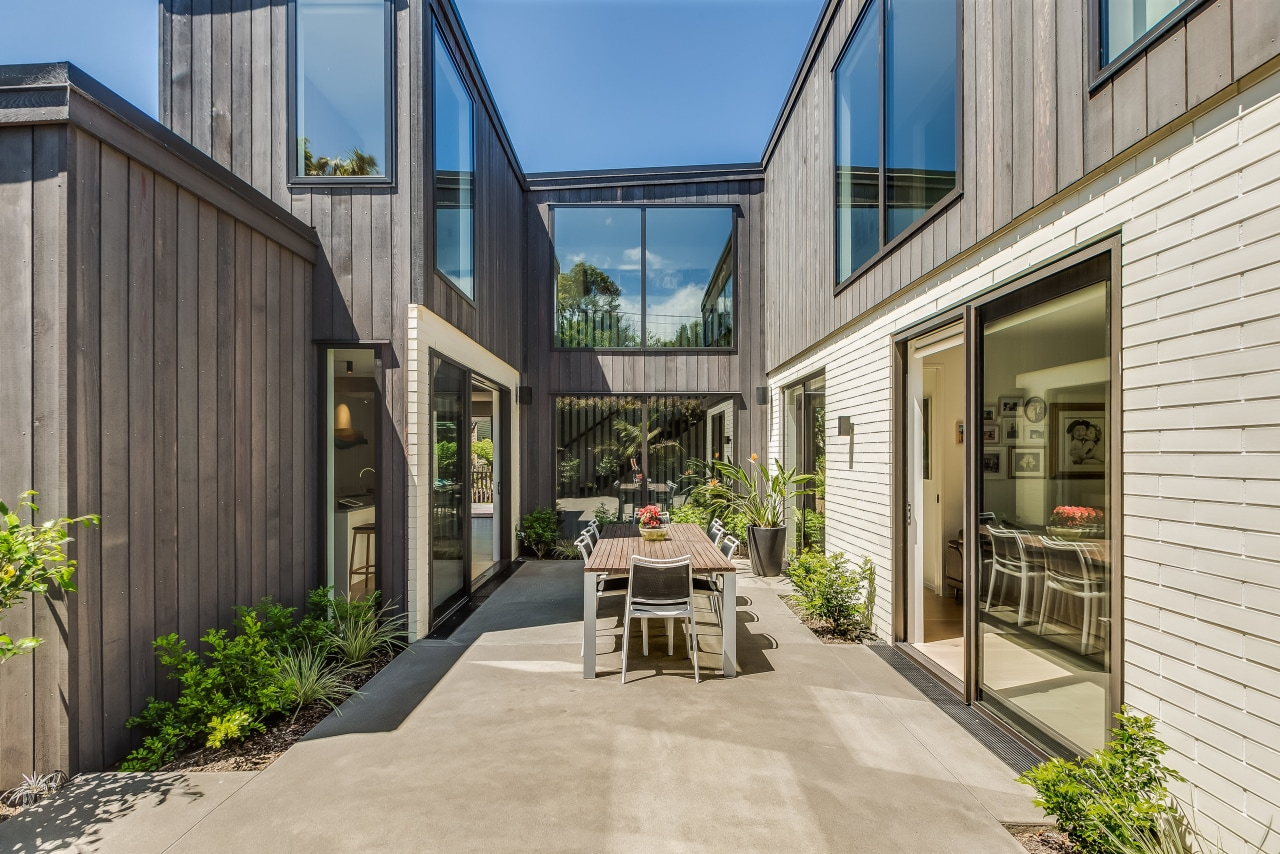 The U-shaped design semi-encloses a sheltered outdoor space