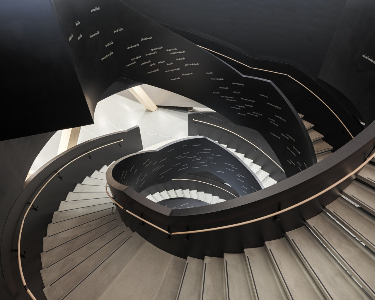 For the Helsinki library, the complex curved geometry architecture, automotive design, font, material property, stairs, black, gray