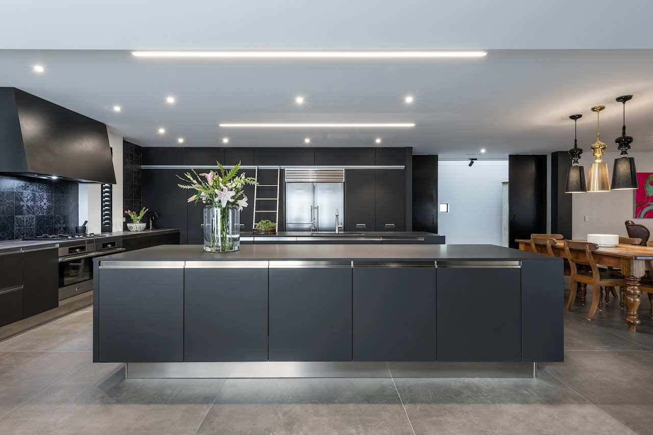 Matt stainless steel toekicks complete this metal-look kitchen gray, black