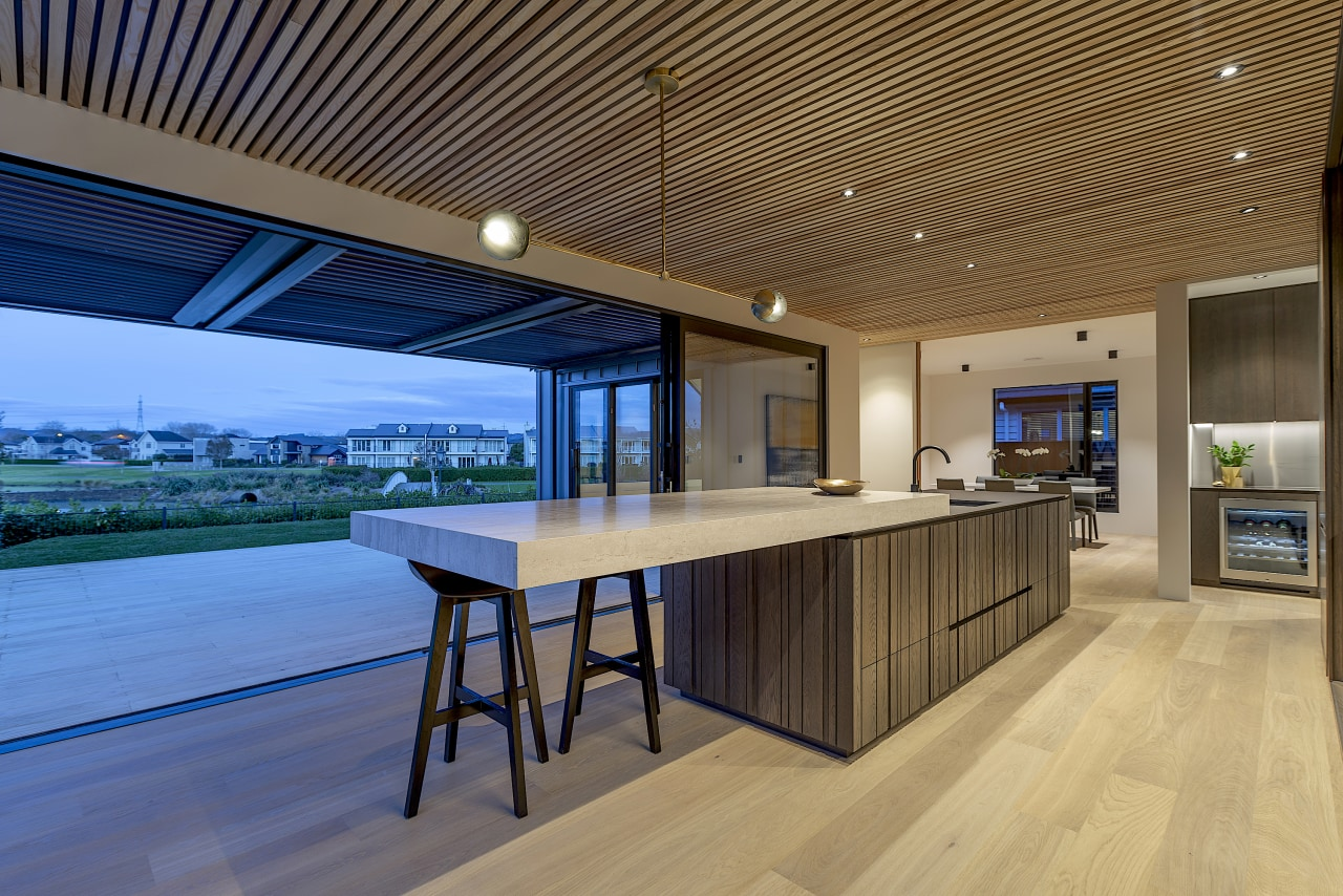 This kitchen – by Cube Dentro – sits architecture, building, ceiling, condominium, deck, design, estate, floor, flooring, furniture, hardwood, home, house, interior design, lighting, porch, property, real estate, roof, room, shade, table, wood, wood flooring, brown