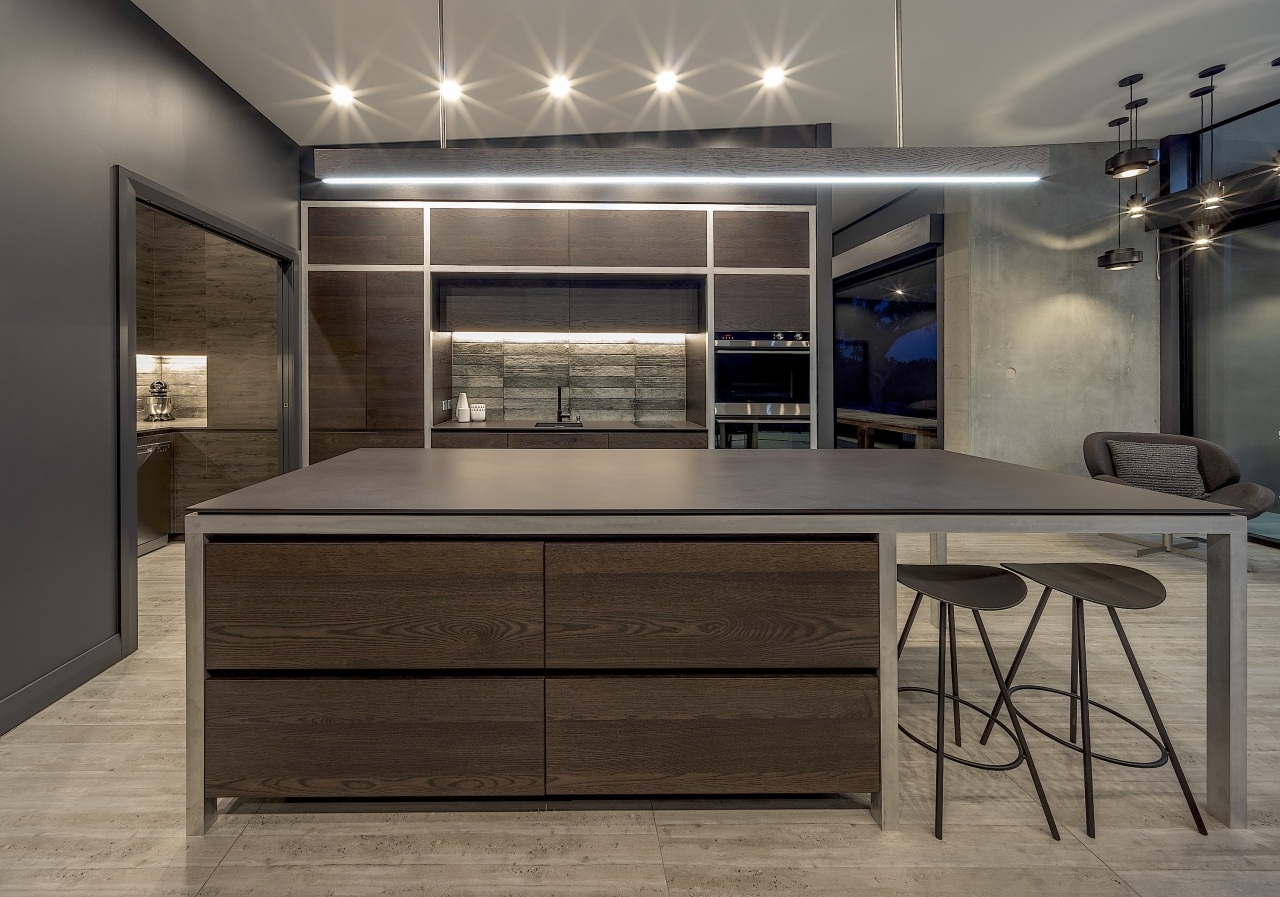 Dark-toned and linear, this kitchen matches the character gray, black