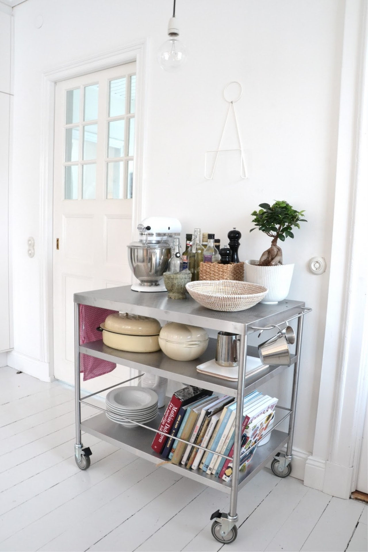 This kitchen cart from Ikea can fit floor, furniture, home, living room, product, shelf, shelving, table, white