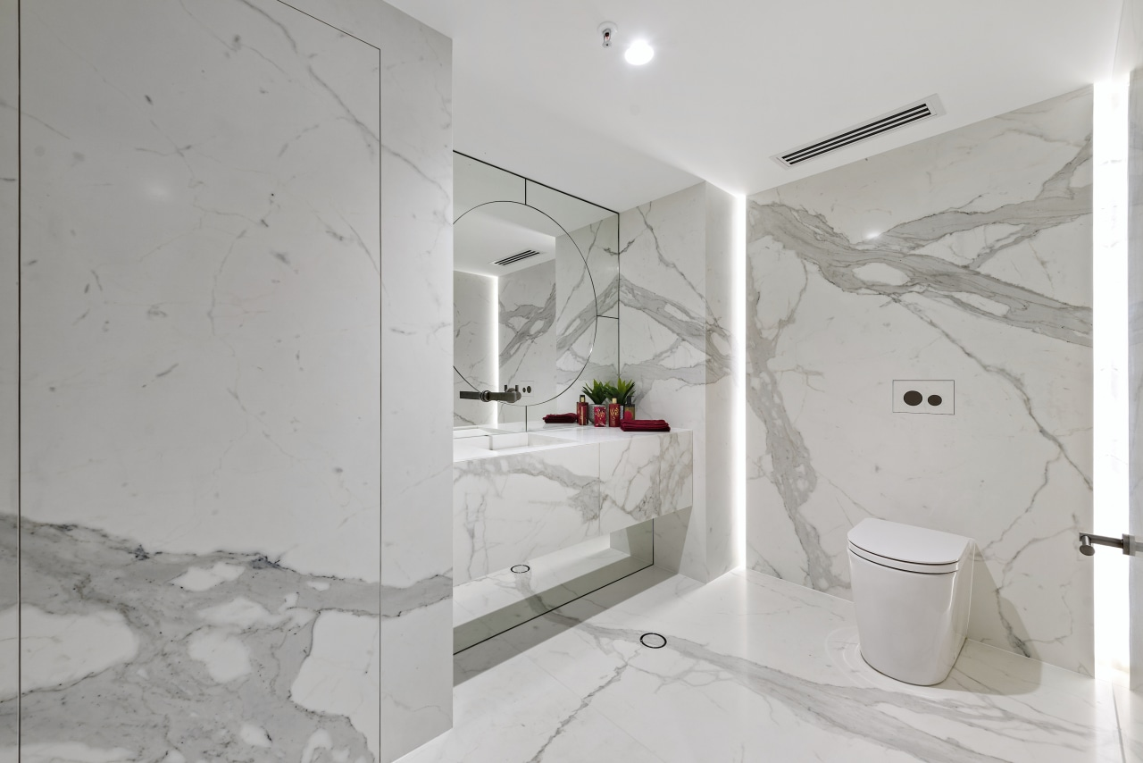 The entire powder room looks like it has