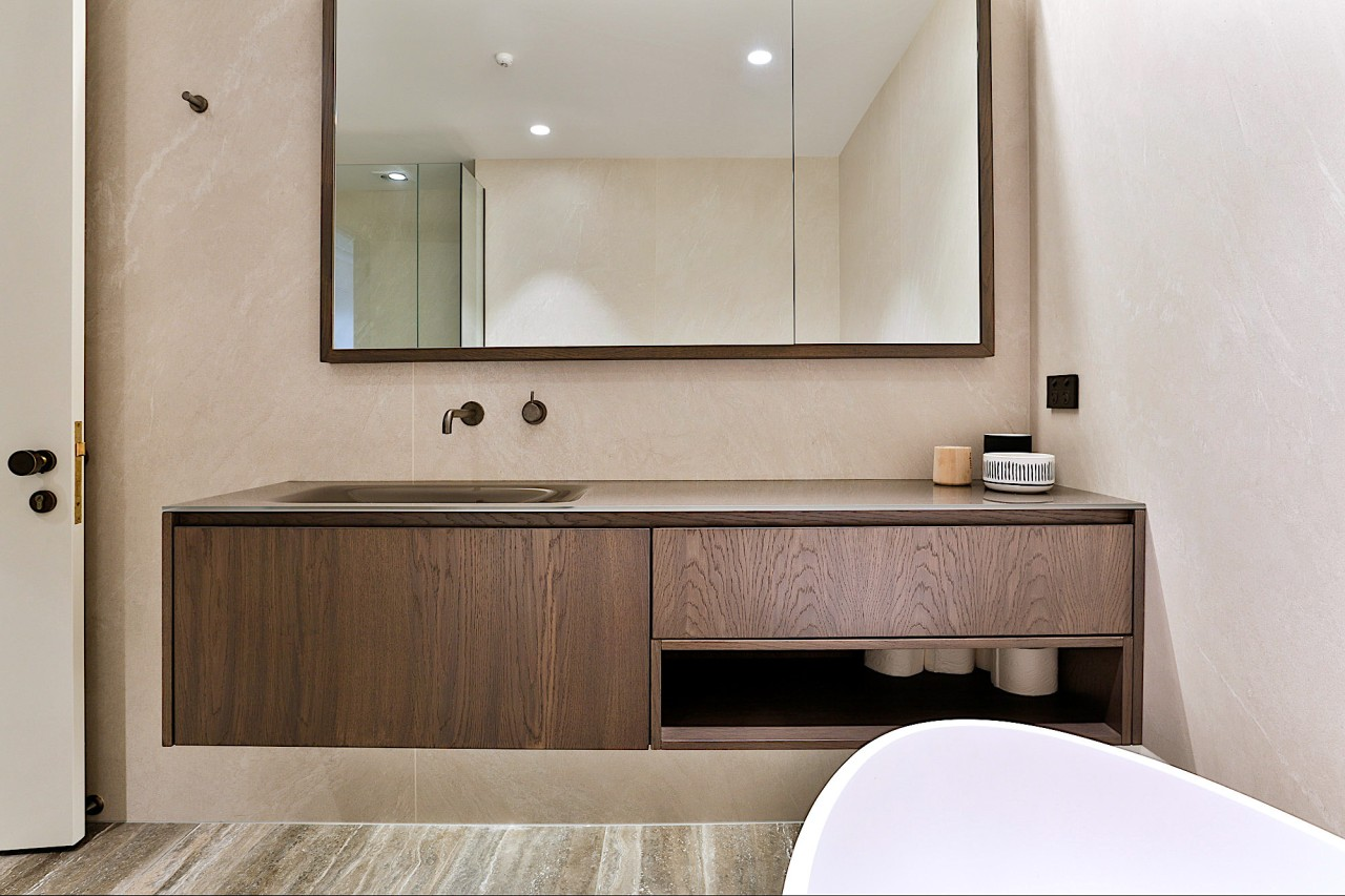 This bathroom's vanity combines a Falper glass benchtop