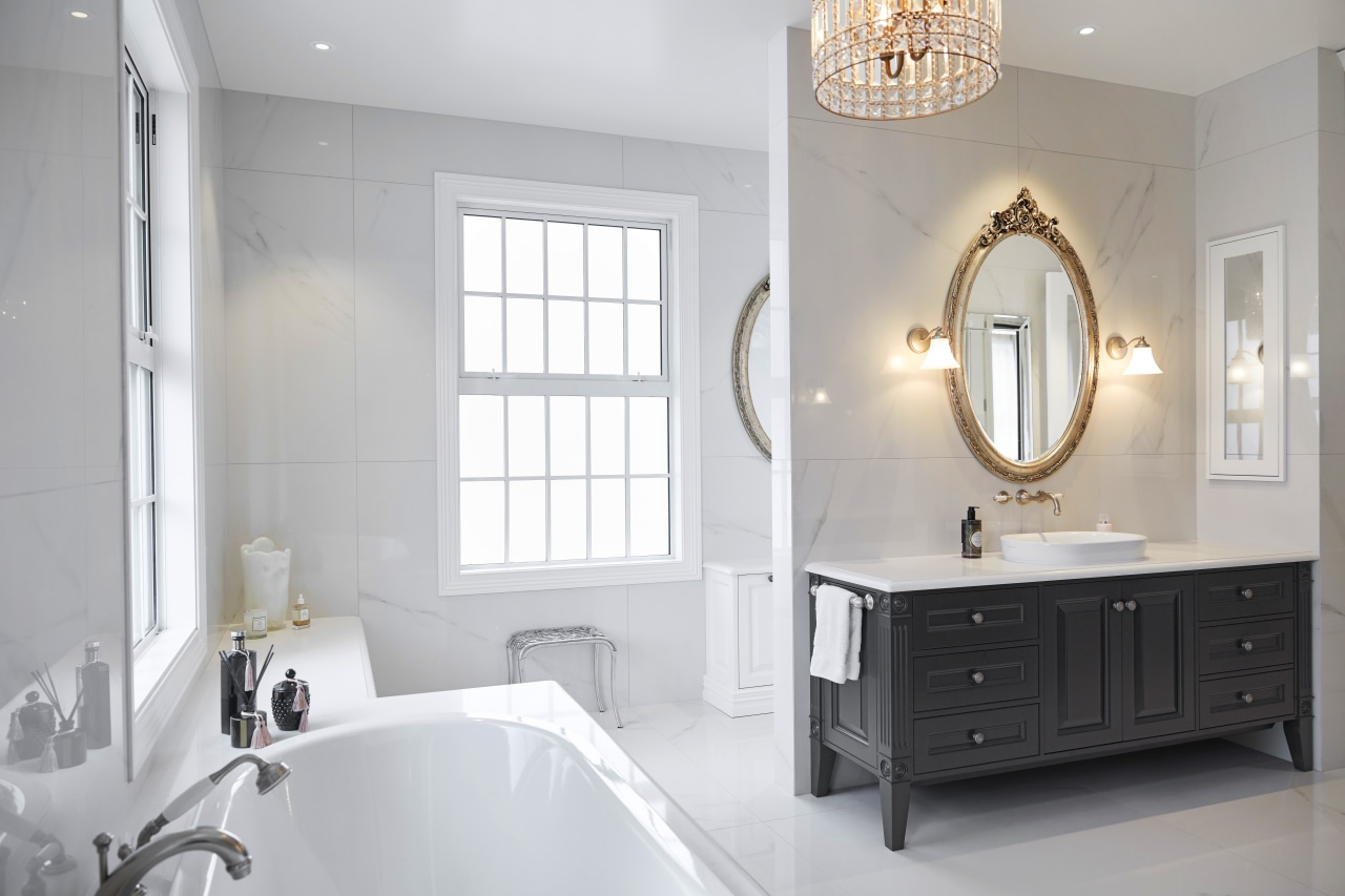 ​​​​​​​His and her vanities in this ensuite have architecture, bathroom, ensuite, bathroom accessory, bathroom cabinet, bathtub, floor, flooring, tiles, lighting, marble, sink, tap, tile, ingrid geldof design