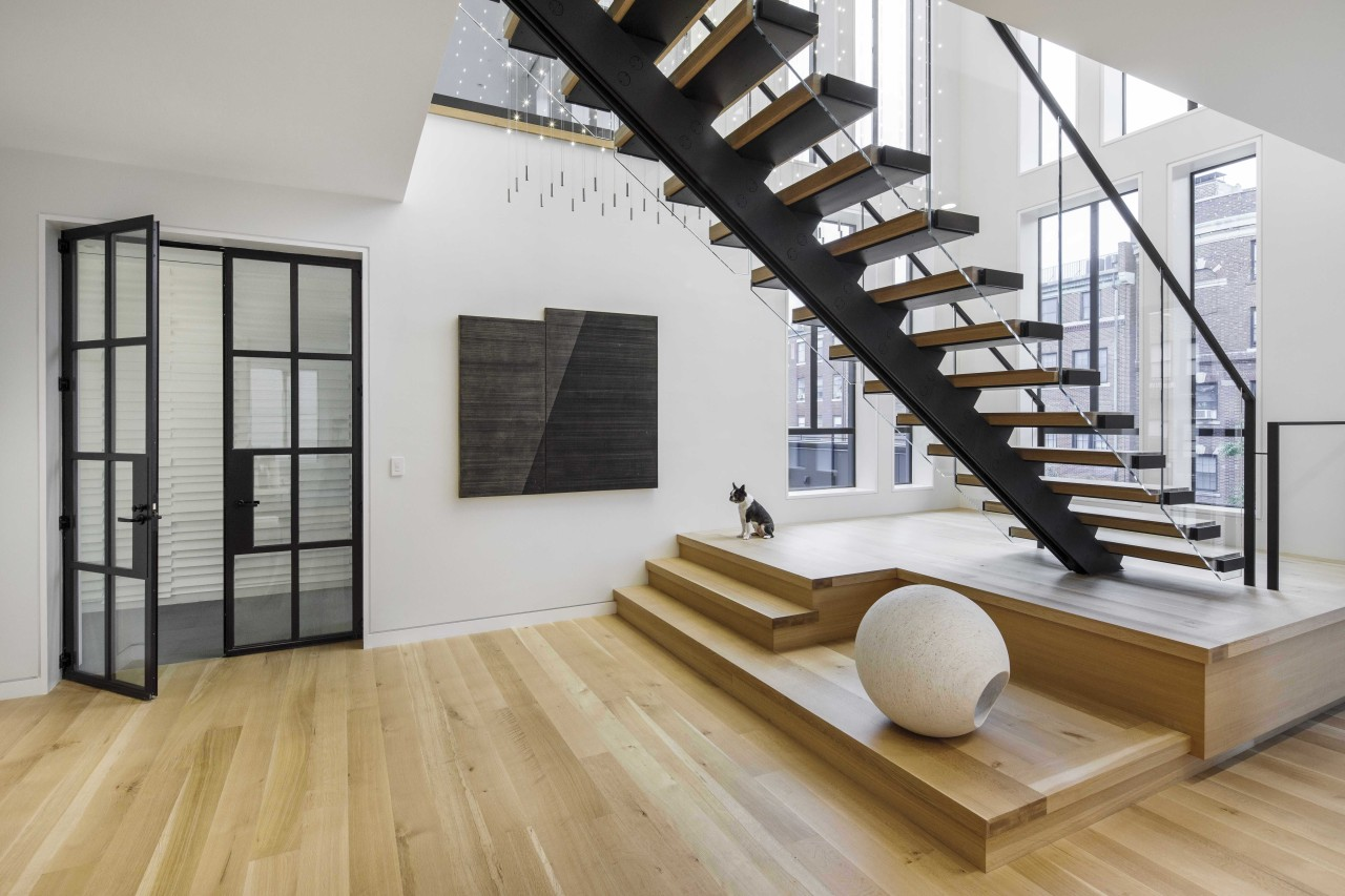 The duplex is connected by a double-height atrium,