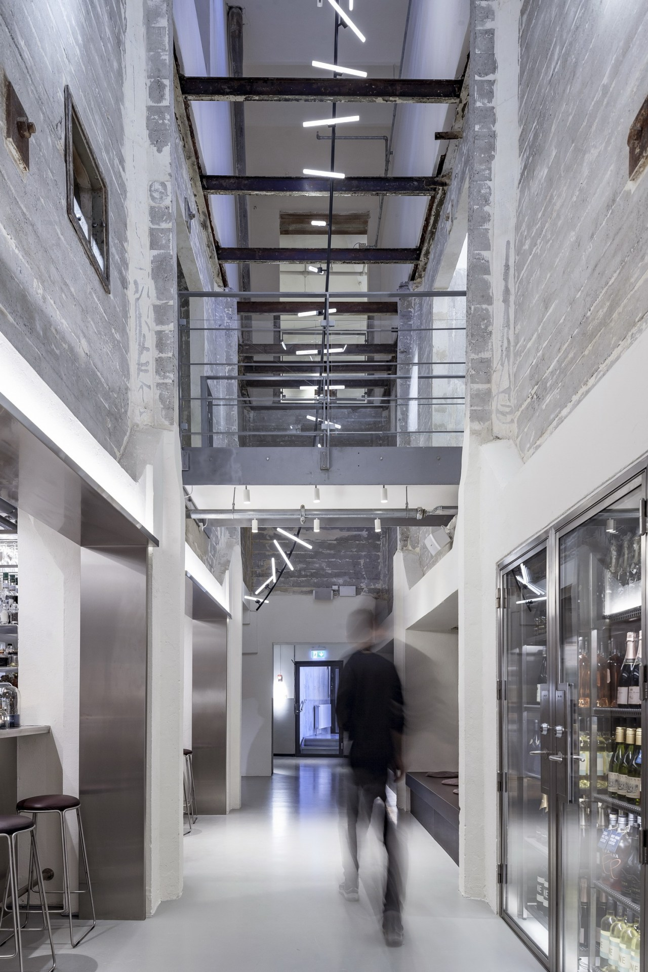 Sandblasted and dust-absorbing coated fair-faced concrete is on architecture, building, ceiling, commercial building, daylighting, design, glass, interior design, lobby, metropolitan area, mixed-use, gray