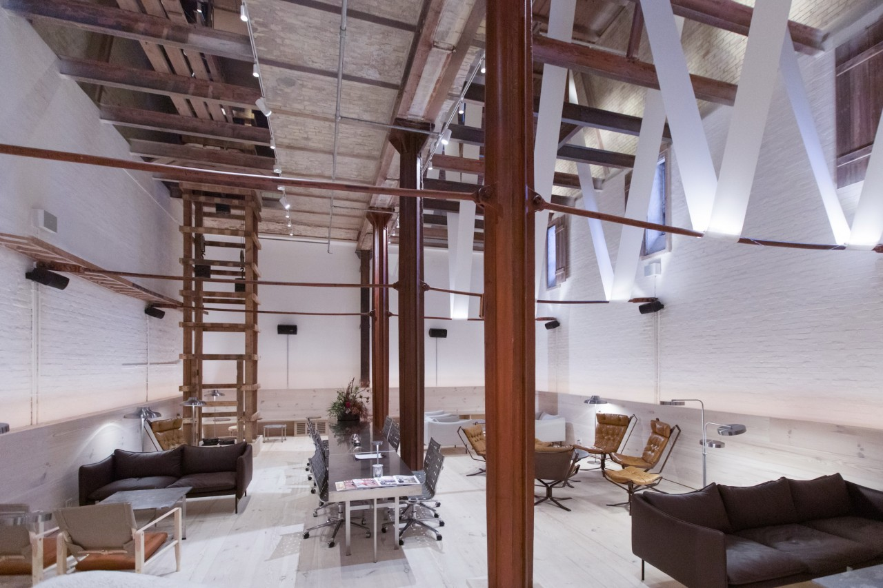 Rough industrial surfaces are balanced by restrained furniture architecture, building, ceiling, floor, flooring, furniture, home, house, interior design, loft, property, room, stairs, gray