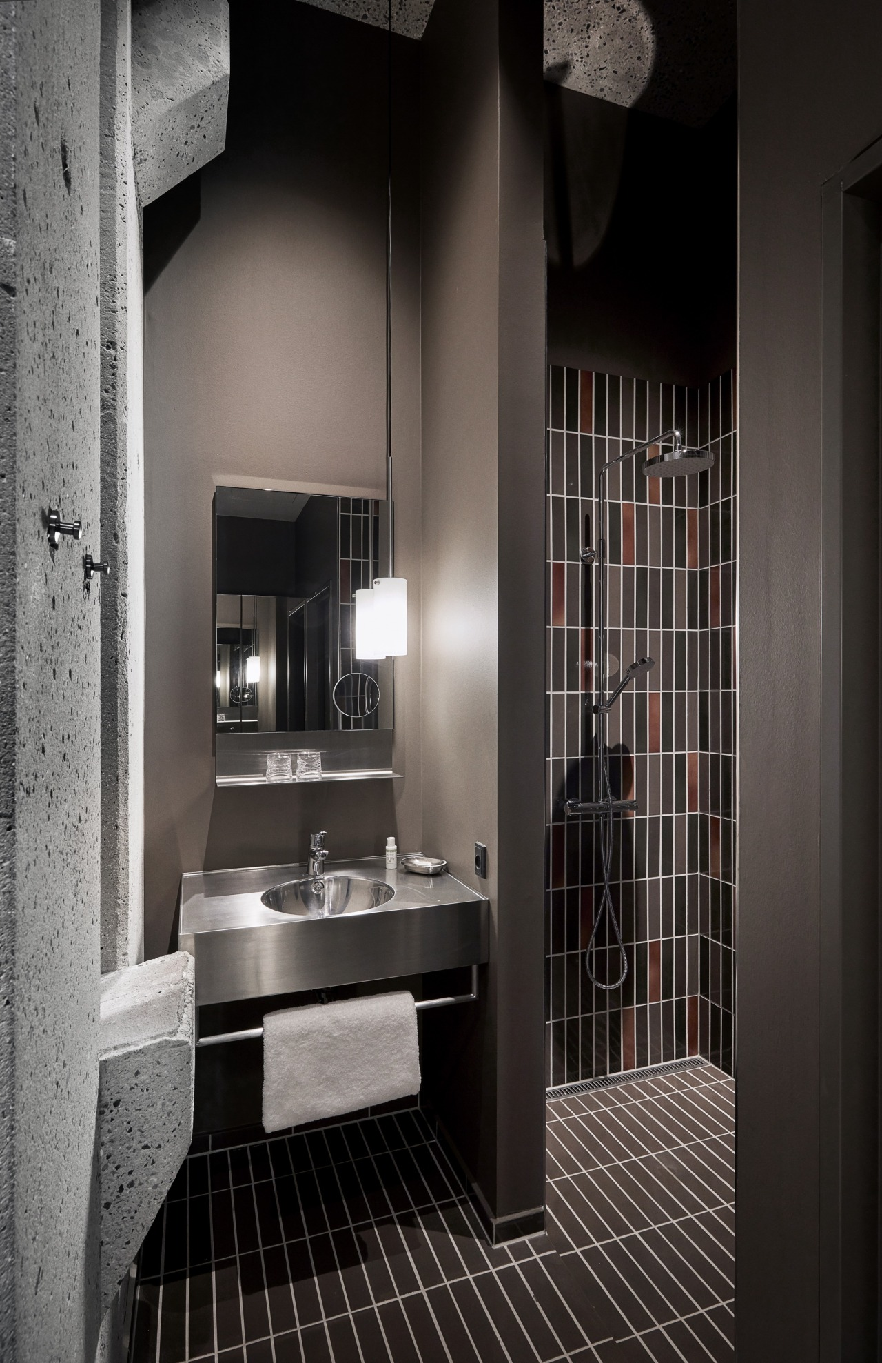 Concrete, tile and steel are combined to create architecture, bathroom, black, black-and-white, building, ceiling, floor, flooring, furniture, home, house, interior design, property, room, tile, black, gray