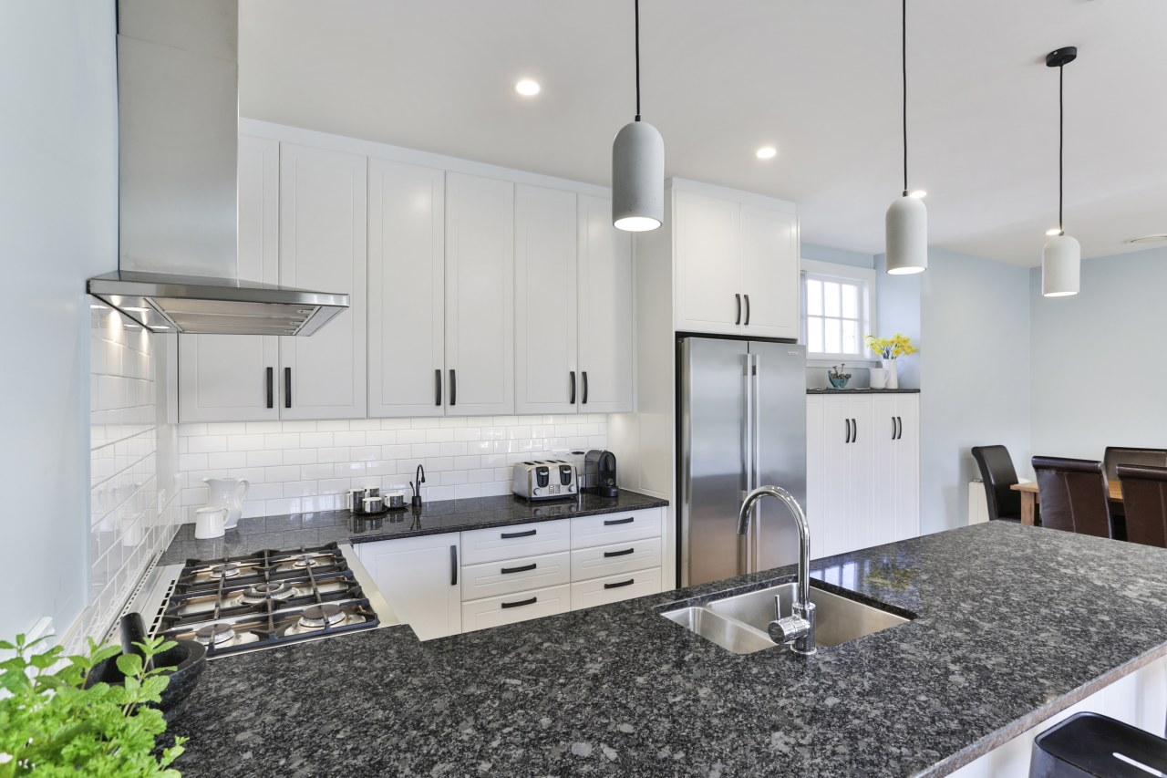The granite island benchtop – with sink, seating countertop, interior design, kitchen, real estate, gray