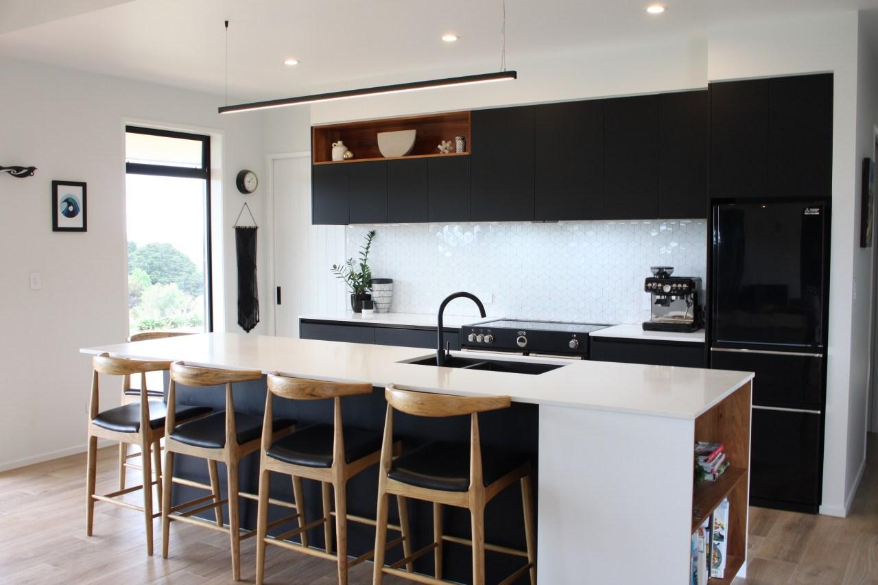 The beautiful, hardwearing kitchen features Habita Castagno woodgrain