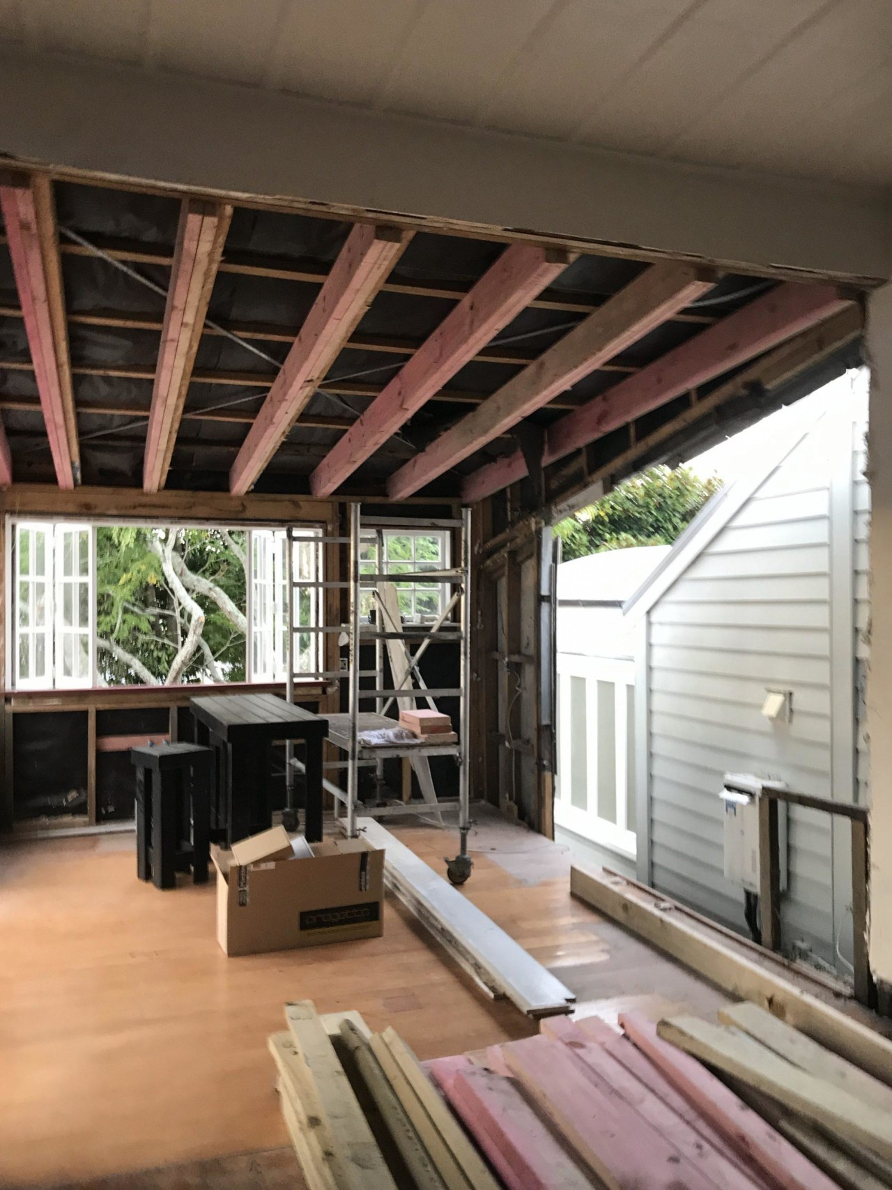 We had a whole wall removed and re-clad, architecture, beam, building, ceiling, daylighting, deck, floor, hardwood, home, house, interior design, loft, property, real estate, roof, room, window, wood, wood flooring, black