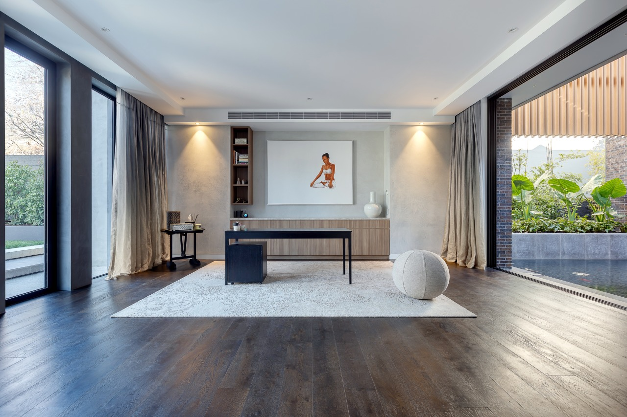 Wood floors run throughout the interior, including into