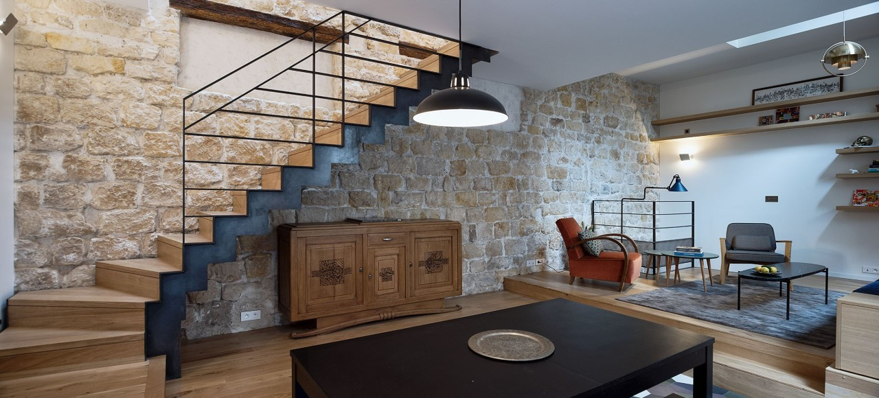 The building had to be entirely recreated, only architecture, brick, building, ceiling, countertop, floor, flooring, furniture, hardwood, home, house, interior design, living room, loft, property, real estate, room, stairs, stone wall, table, wall, wood, gray