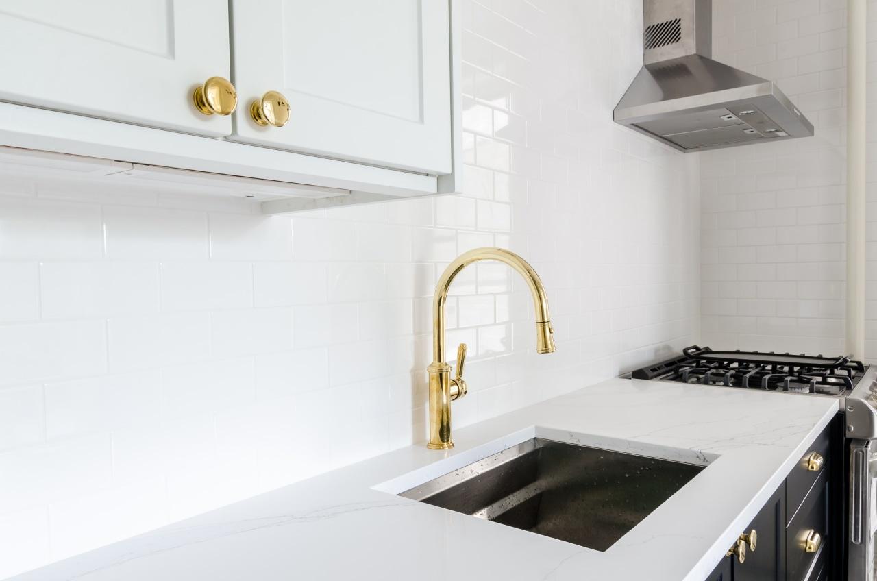 Kitchen sink with brass tap -