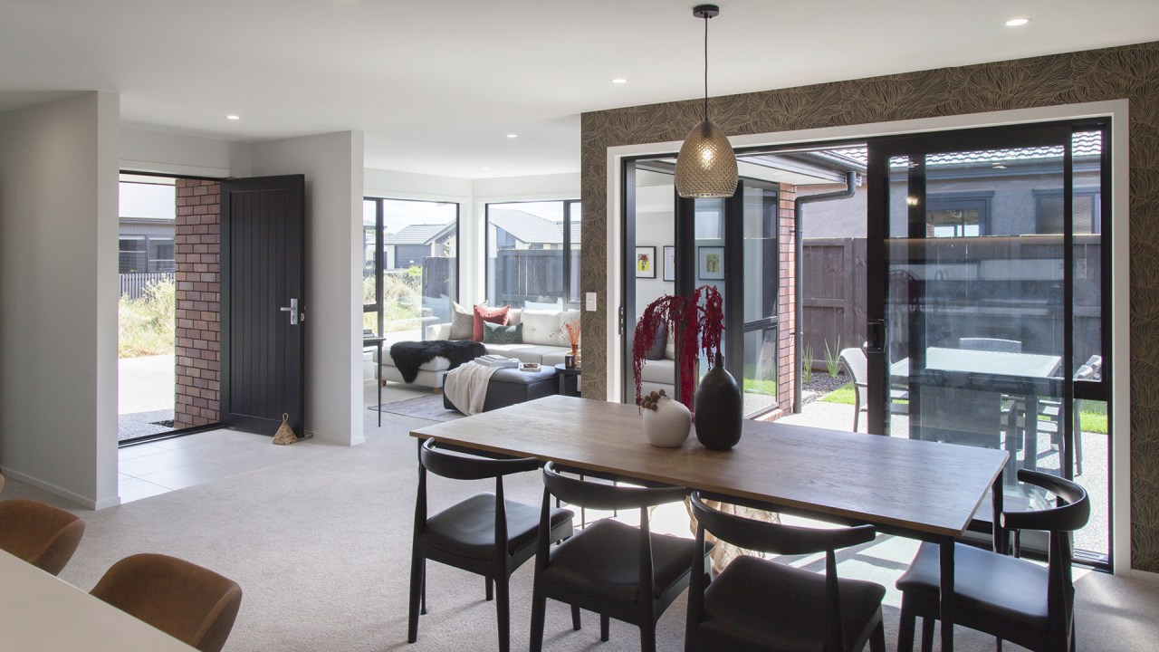 Natural light floods into the home's expansive open-plan