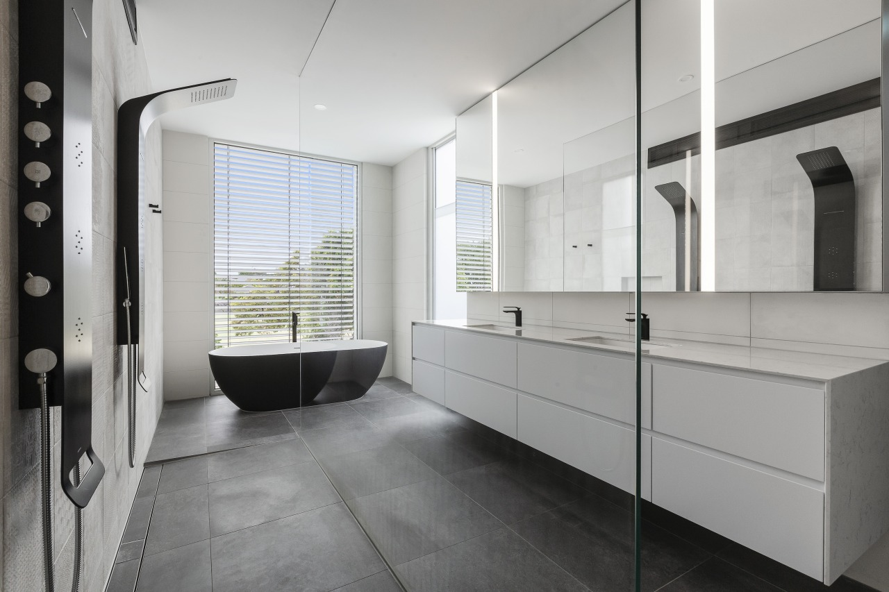 Pared back and sculptural, this bathroom boasts several