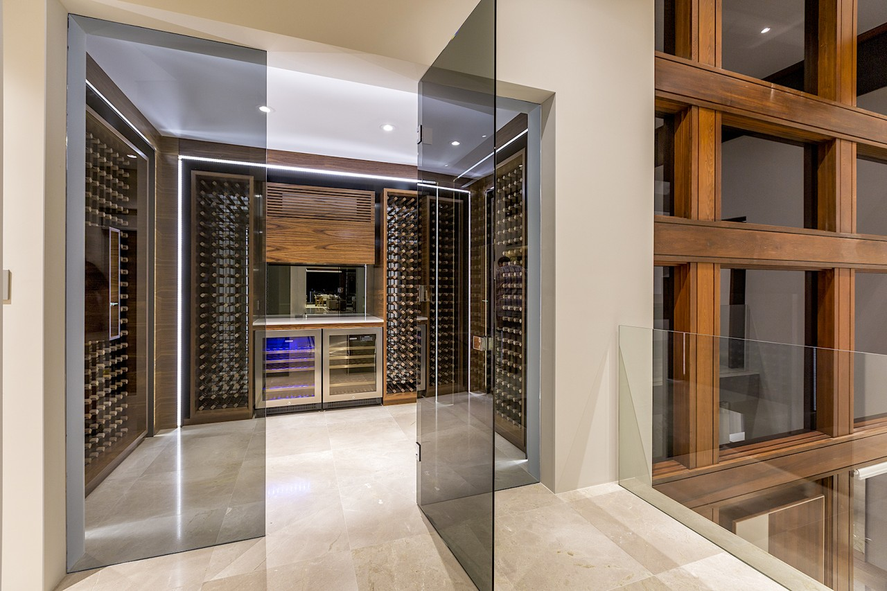 This wine room in a luxurious Perth home architecture, automotive exterior, building, ceiling, door, facade, floor, flooring, furniture, glass, home, house, interior design, property, real estate, room, tile, gray