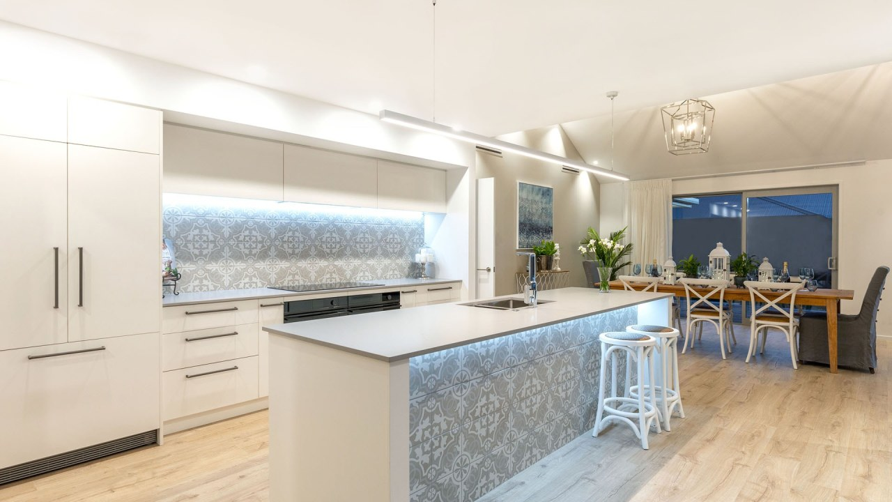 Pale wood laminate floors complete the modern entertaining