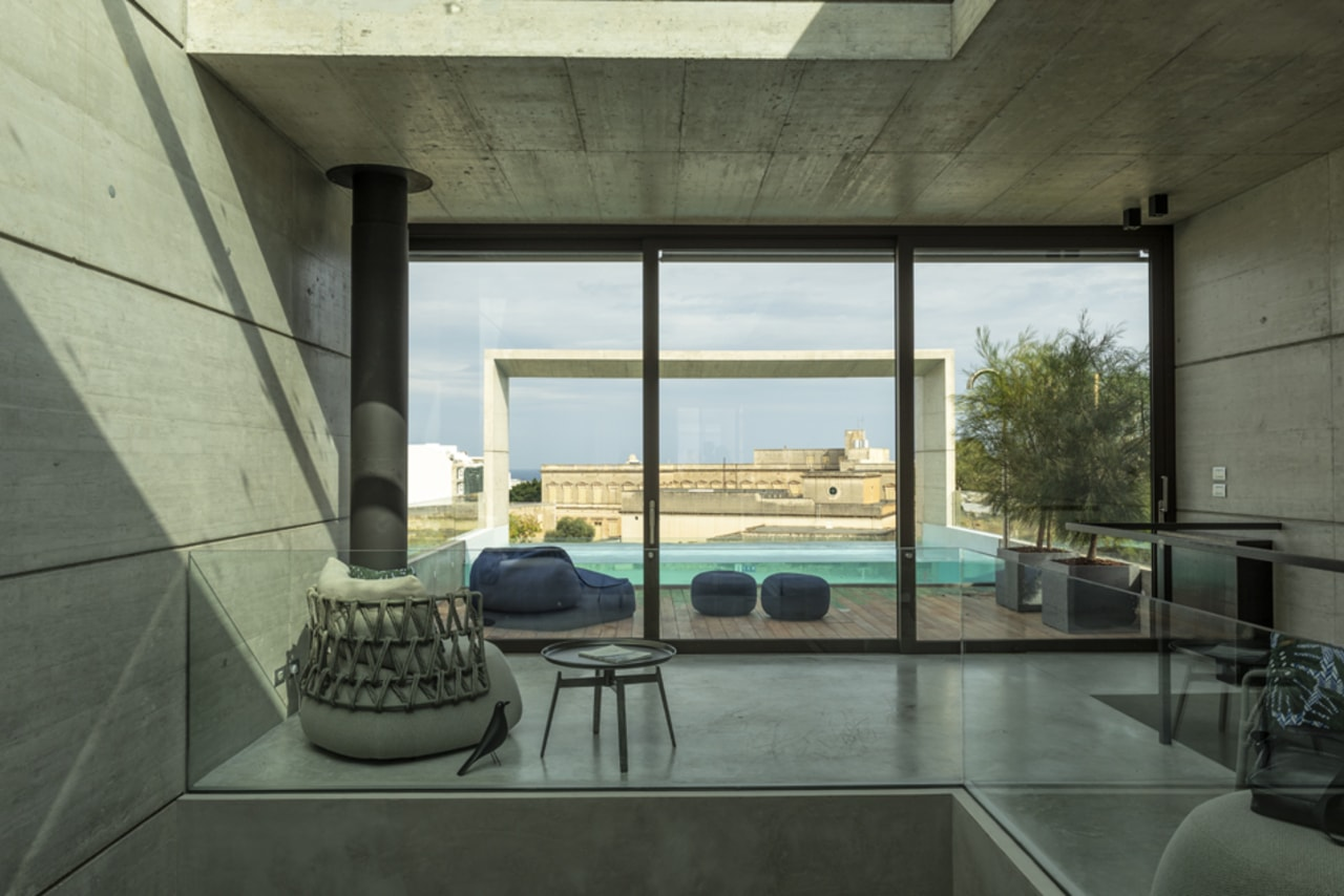 The view from the kitchen across to the architecture, building, ceiling, concrete, daylighting, floor, flooring, furniture, glass, home, house, interior design, living room, loft, property, real estate, room, shade, table, window, black, gray