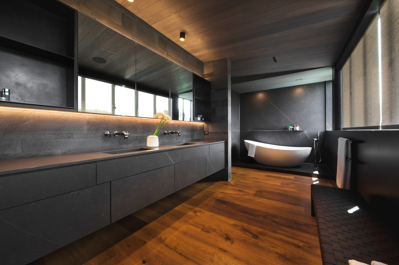 The floating vanity is fabricated from large Neolith