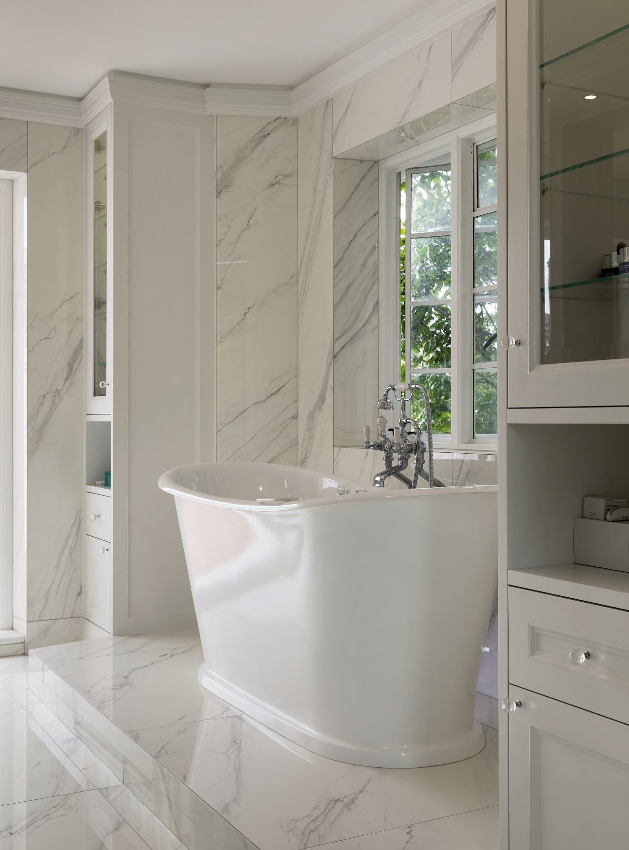 The shower and bathtub are both on plinths,