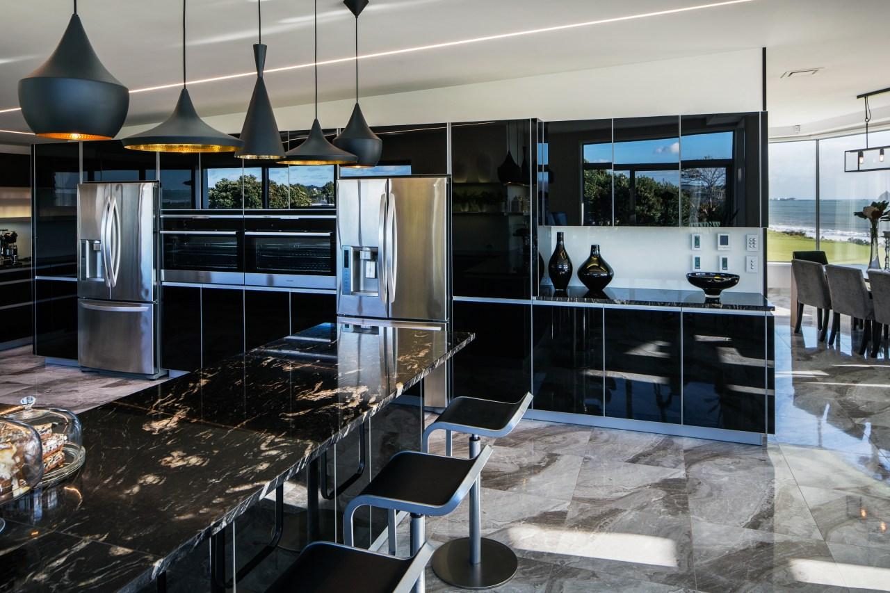 Designer Damian Hannah specified black German glass doors countertop, interior design, kitchen, gray, black