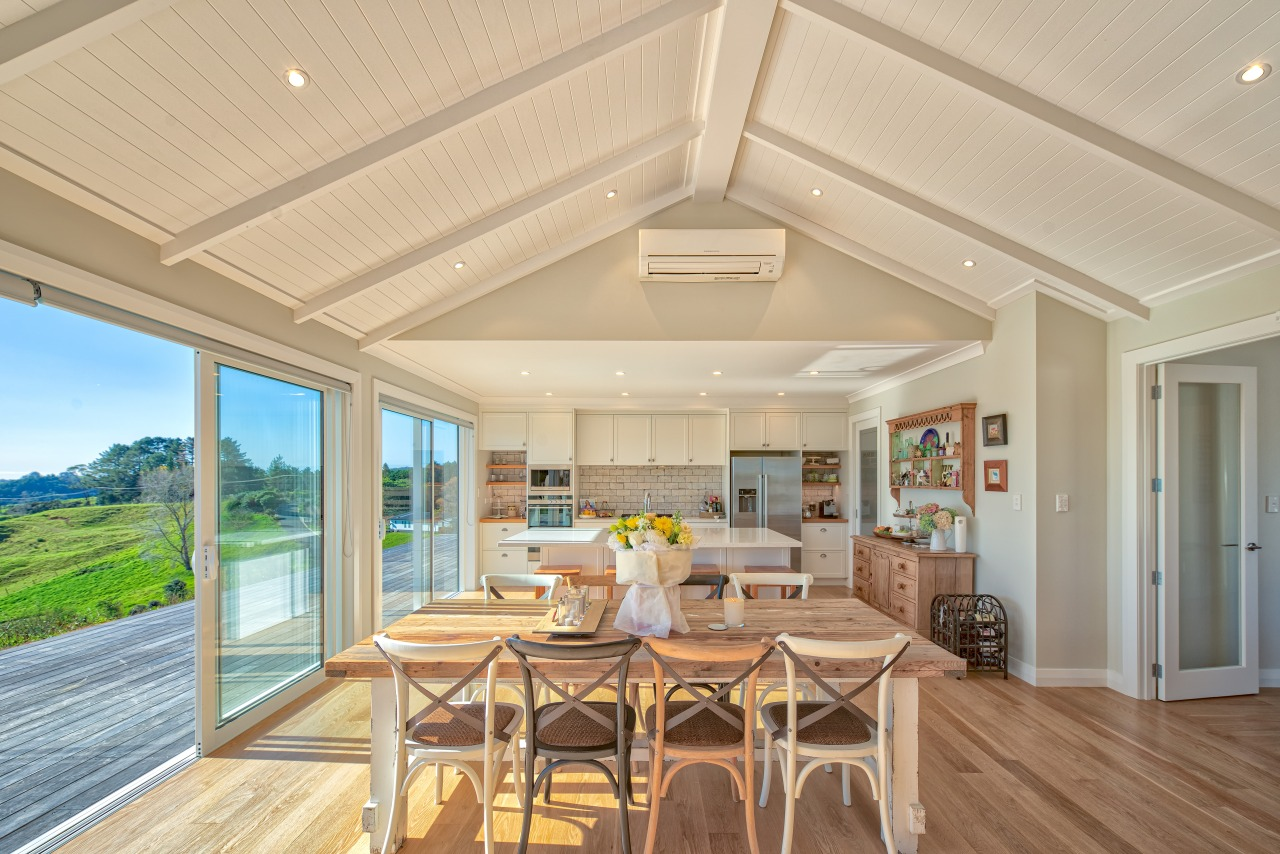 A soaring 2.7m tongue-and-groove ceiling sets off this timber ceiling, hardwood, home, house, interior design, living room, real estate, window, wood flooring, orange, open plan living,  fowler homes