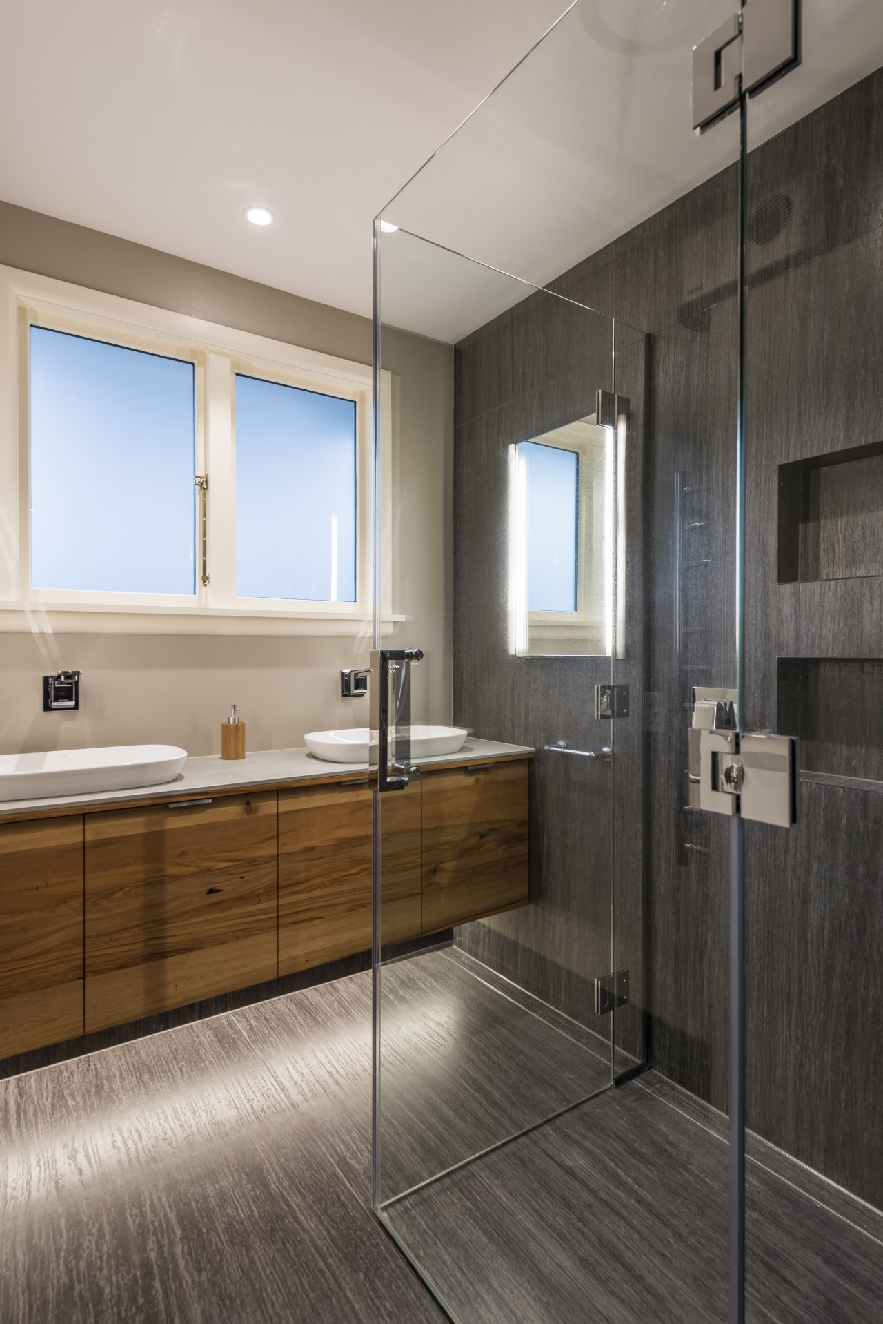 When in use, the shower looks like a bathroom, floor, flooring, interior design, basin, tile, shower, CDK Stone, Caroma, methven, Higham architects