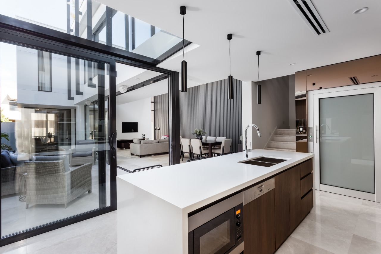 Sliding doors in front of this kitchen open countertop, house, interior design, kitchen, real estate, gray, white