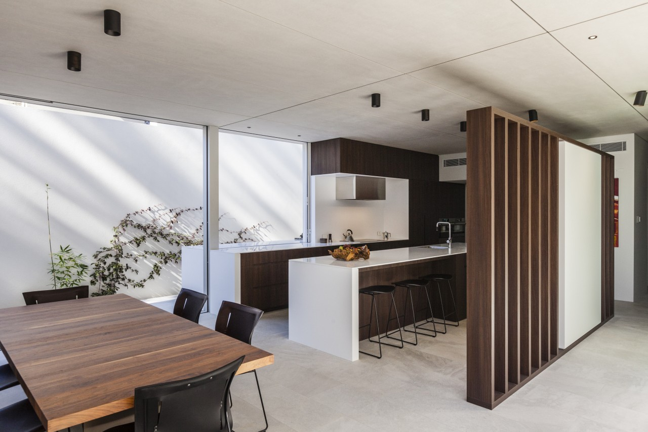 The cabinetry and batten screen are both in architecture, ceiling, interior design, gray
