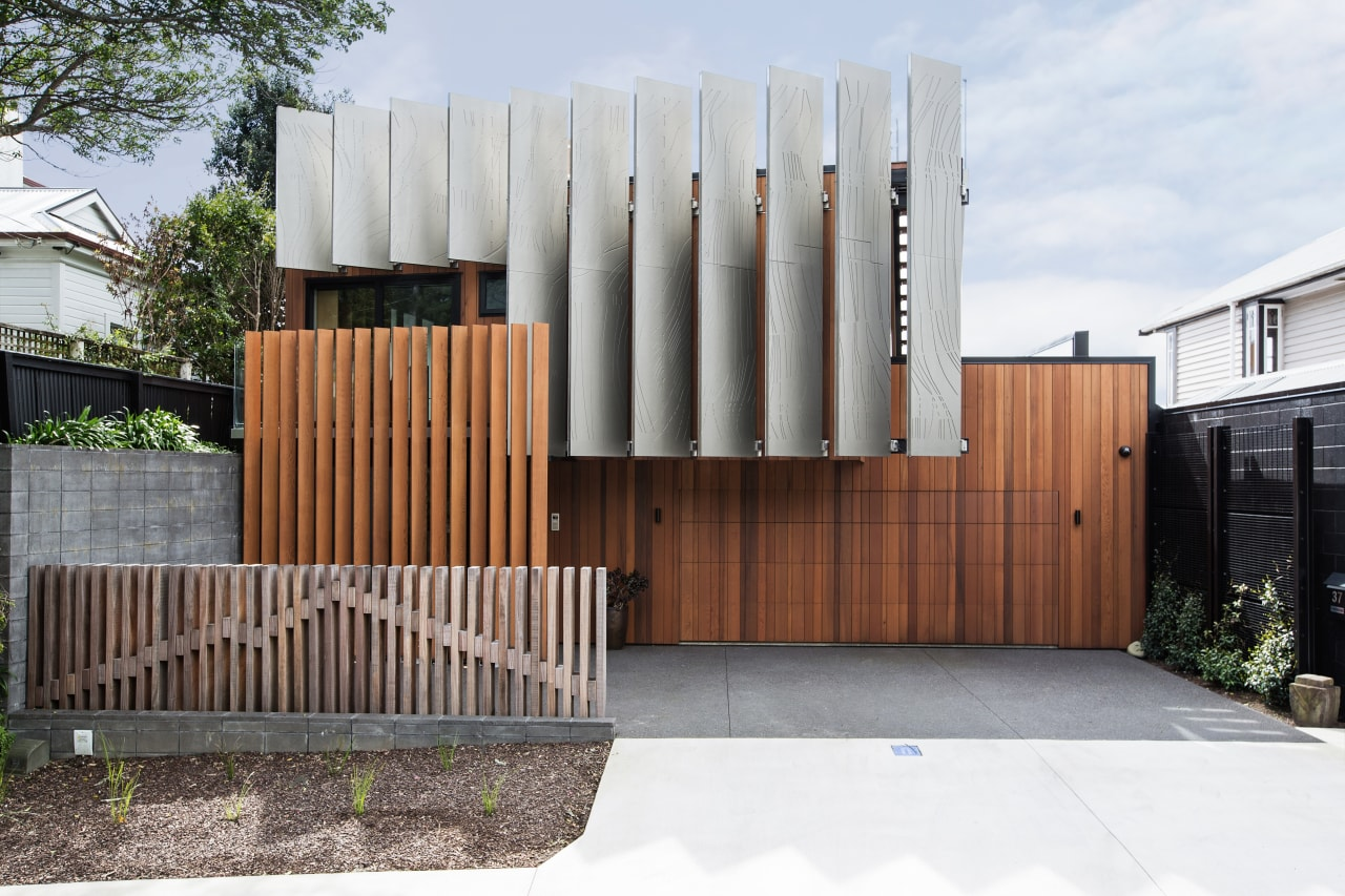 ​​​​​​​A fence depicting Mt Taranaki provides an excellent architecture, facade, house, home, Boon Team Architects, privacy