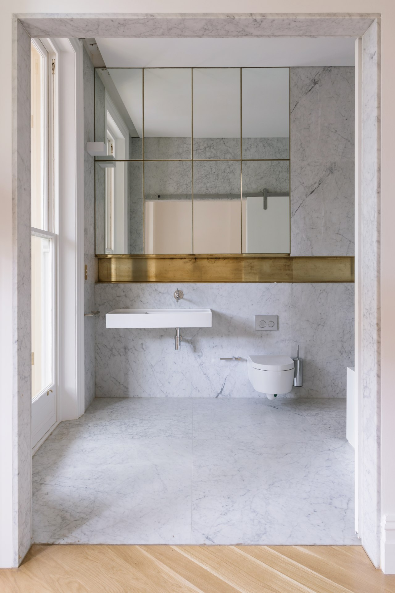 In this bathroom, a classic room-high sash window architecture, bathroom, bathroom accessory, bathroom cabinet, floor, interior design, sink, gray