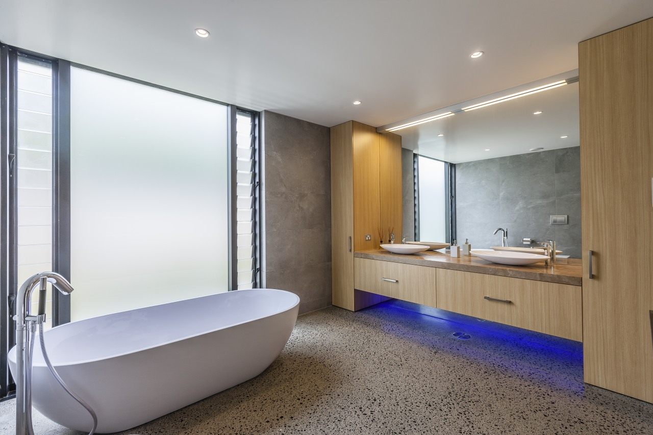 Atmospheric lighting and a freestanding tub accompany bespoke architecture, bathroom, room, gray, white, bespoke cabinetry, custom, RH Cabinetmakers, Storeage
