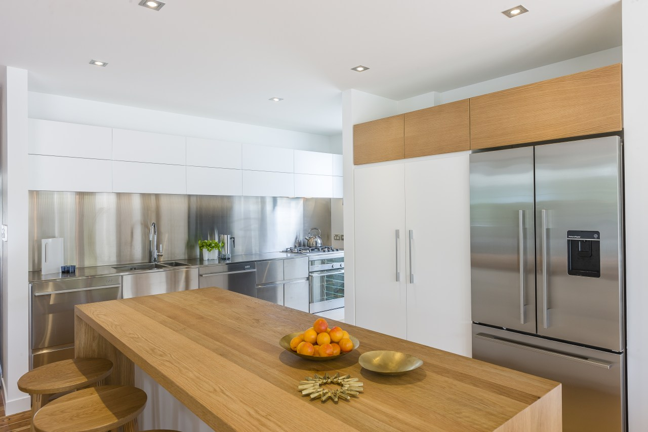 This kitchen comes alive with beautiful hand-crafted wood countertop, interior design, kitchen, real estate, white, gray