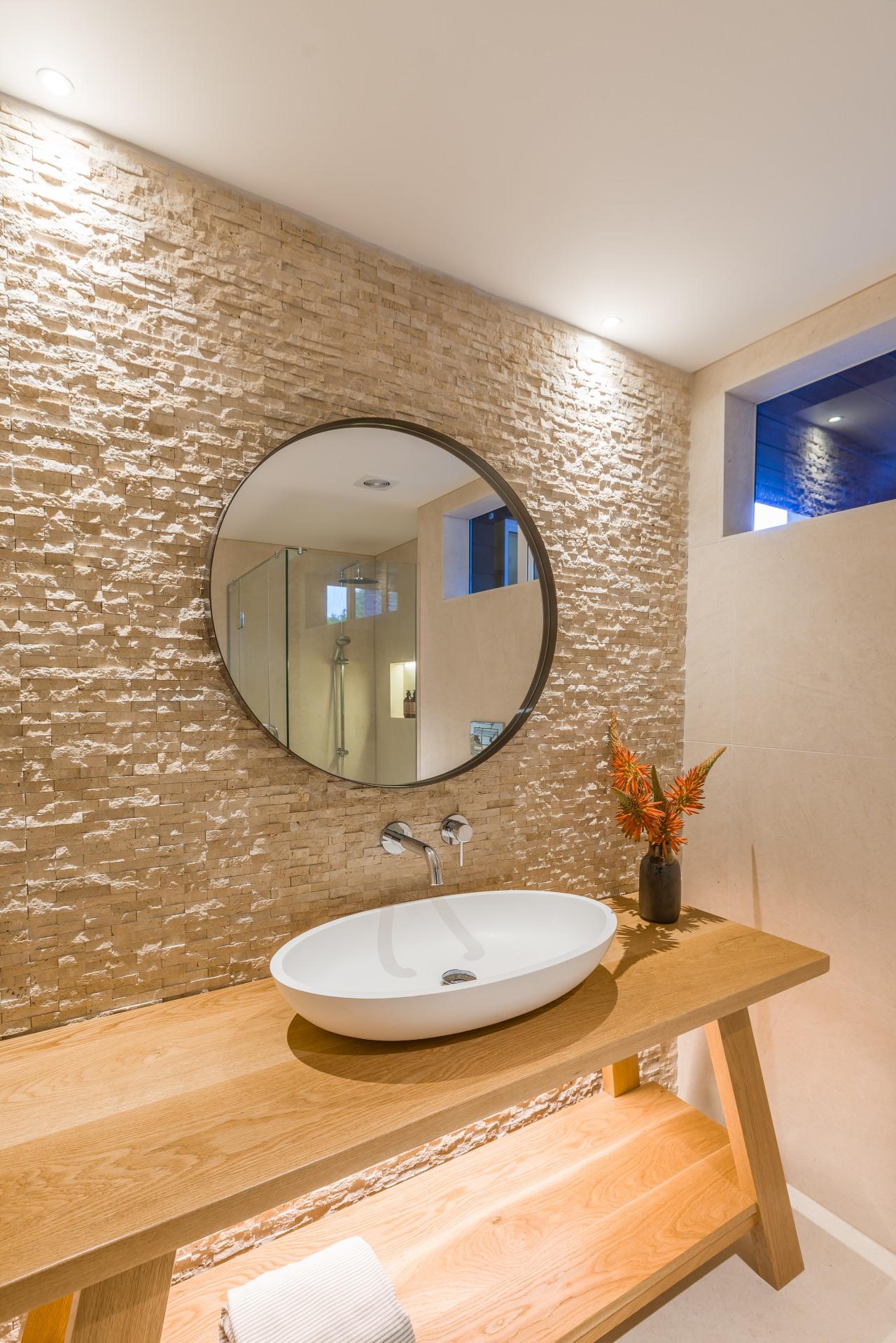 The split-face travertine wall was water-blasted in key bathroom, interior design, sink, Travertine, Natalie du Bois, design