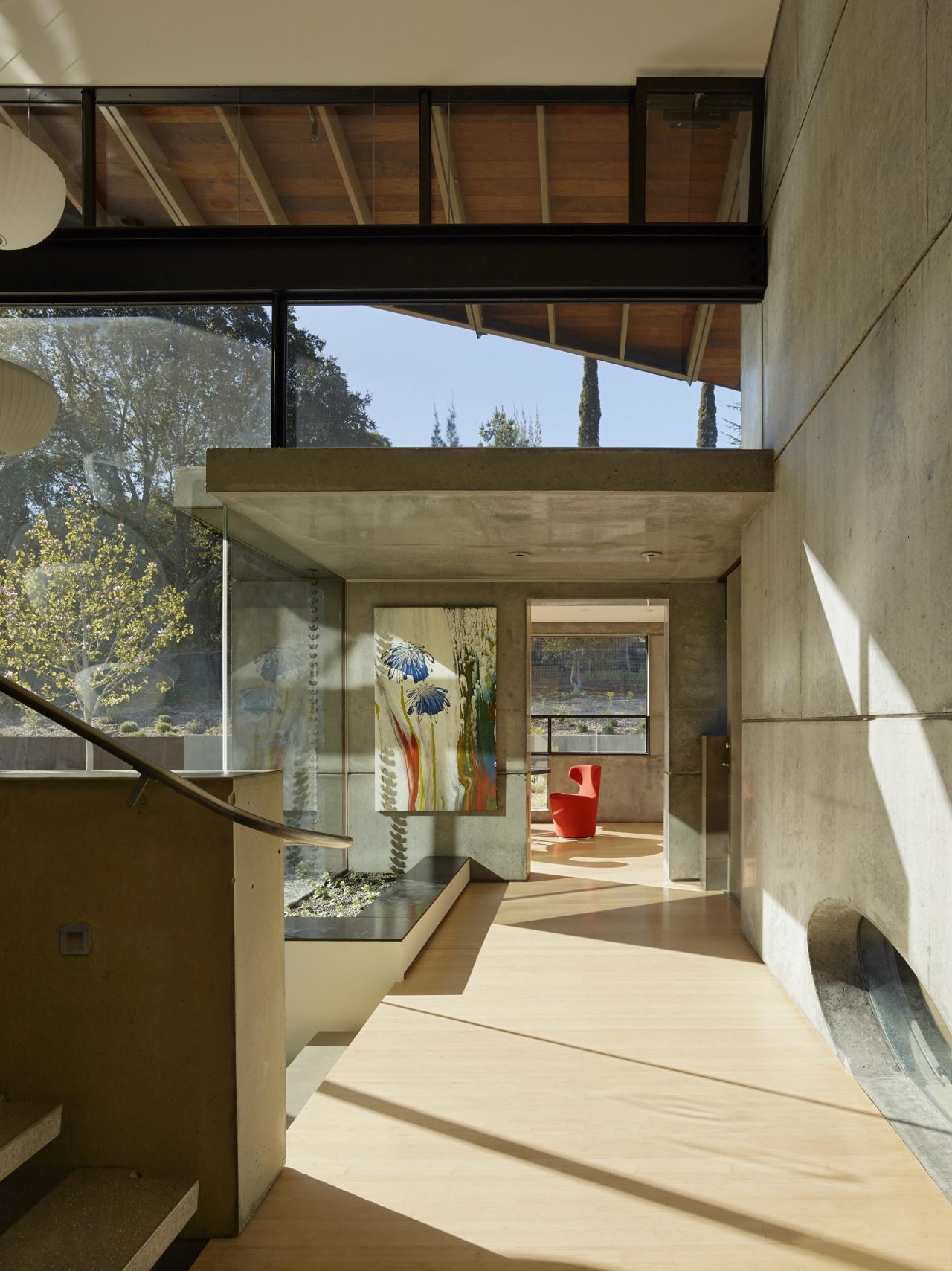 The 38cm-thick concrete walls in this home are architecture, house, home, interior design, heat retention, concrete, entranceway, heating, cooling, FuTung Chen,  Chen Design