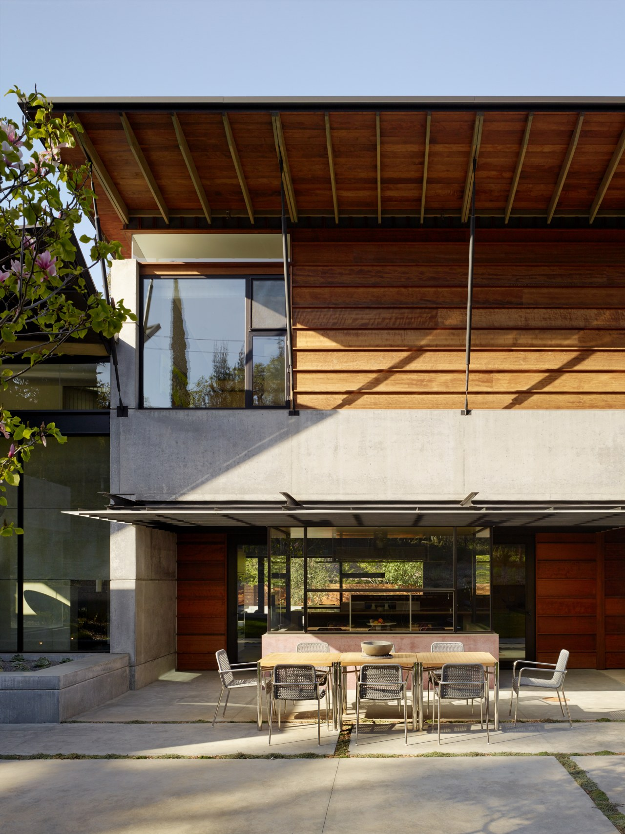 Reclaimed redwood cladding contrasts with the predominantly concrete architecture, house, home, roof, siding, cladding, concrete, redwood, FuTung Cheng, Cheng Design