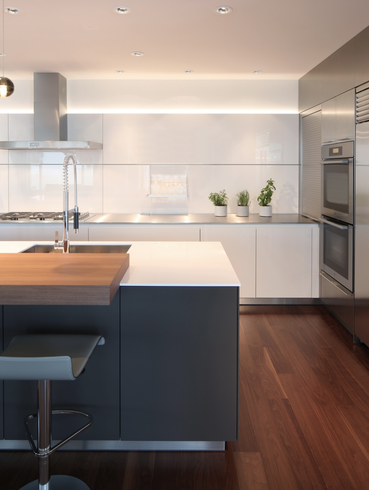 Subtle lighting can make all the difference. For architecture, cabinetry, countertop, flooring, hardwood, interior design, kitchen, laminate flooring, sink, wood flooring, white, William Landeros,  Kitchen Distributors