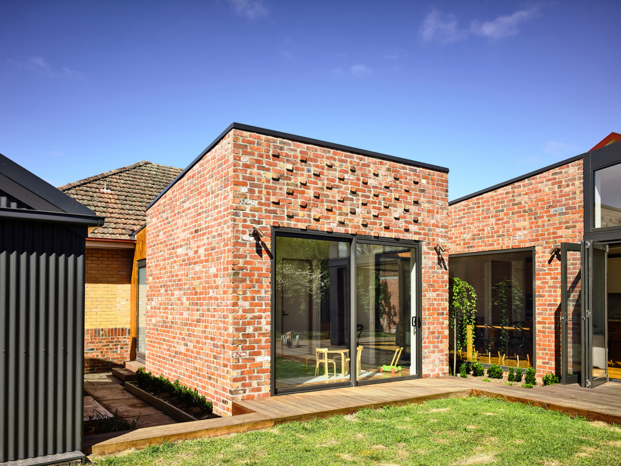 Looking like it is stand-alone, this new rumpus brick, facade, home, house, property, rresidential area, siding, bifold window, brick extension, Porter architecture