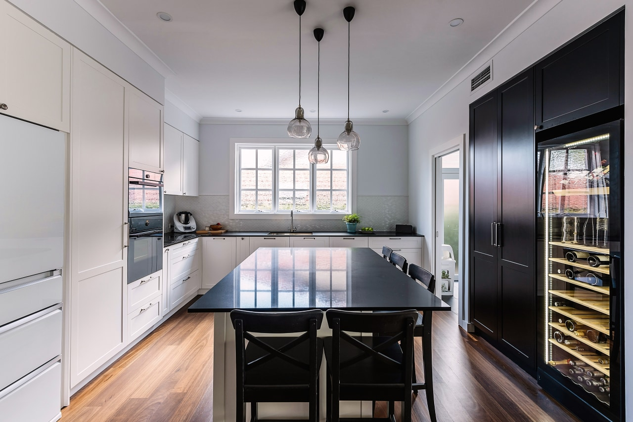 Black pantry on one side of this kitchen cabinetry, countertop, interior design, kitchen, designer kitchen, IL Design, black cabinetry,  ceasarstone