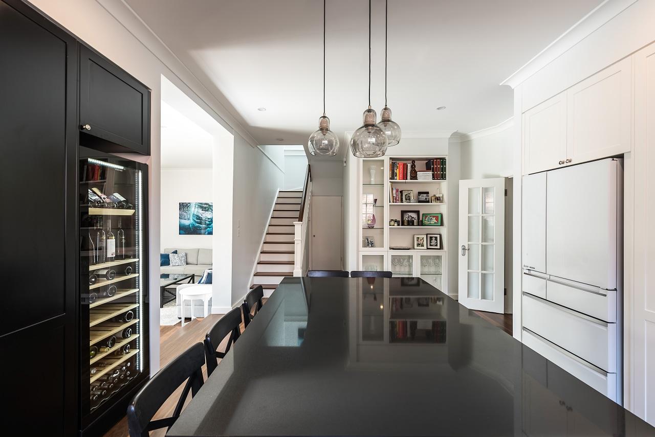 In this entertainer's kitchen, the black pantry on interior design, white, black, kitchen, kitchen design, IL Kitchens, cabinetry,