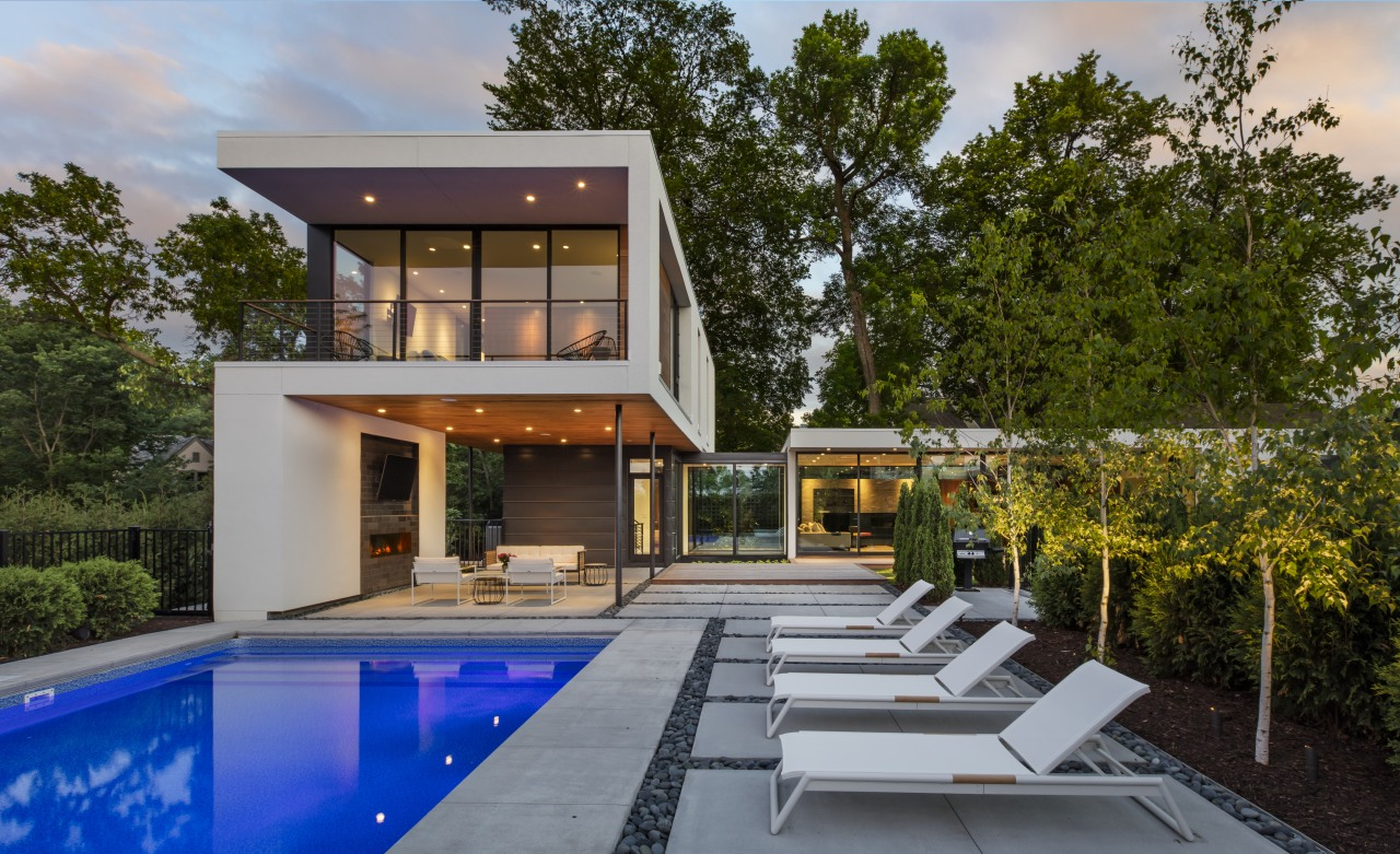 This L-shaped home by Peterssen/Keller Architecture is a architecture, backyard, facade, home, house, swimming pool, Peterssen Keller Architecture, outdoor loungers