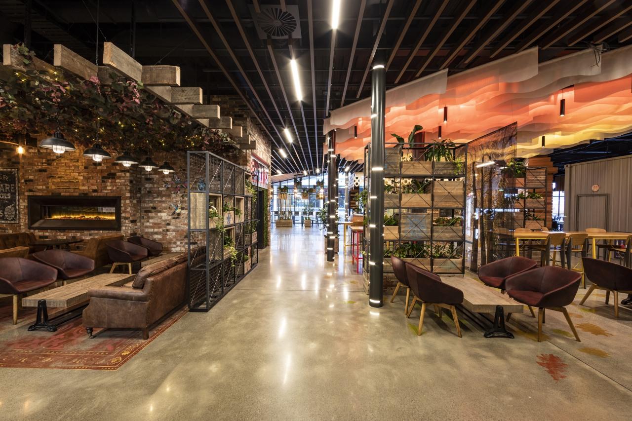 A sightline runs right through the food concourse interior design, restaurant, black, brown