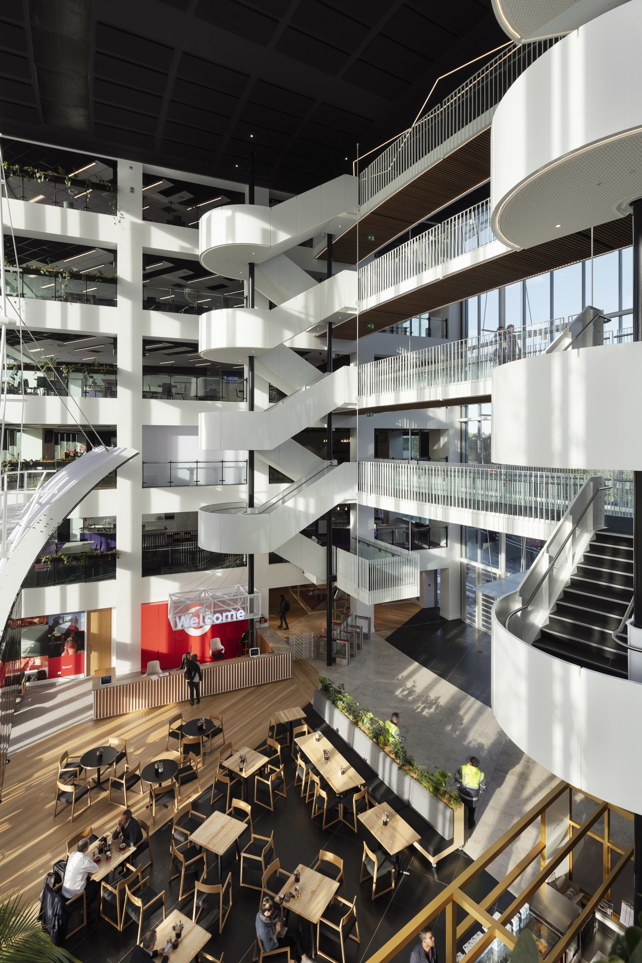 For the new Vodafone InnoV8 building, timber was architecture, building, condominium, corporate headquarters, headquarters, interior design, lobby, metropolis, metropolitan area, mixed use, black, white