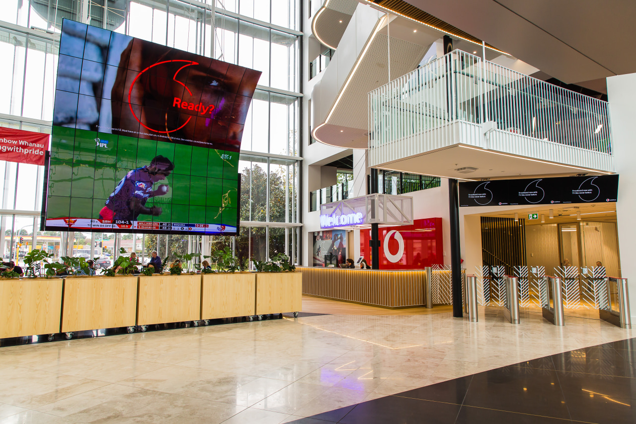 The giant atrium screen in operation at the interior design, lobby, retail, shopping mall, white