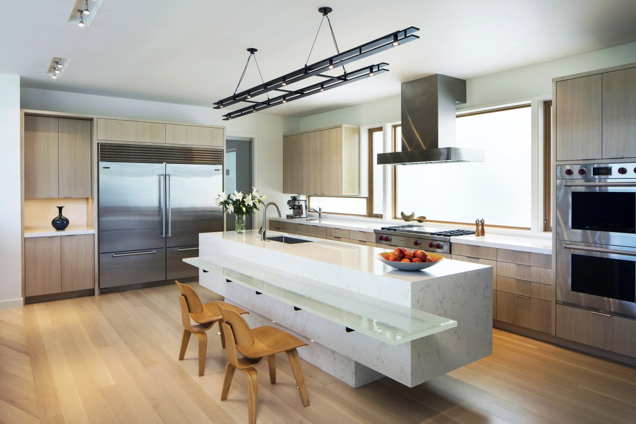 ​​​​​​​A 2.5cm-thick glass counter sits at dining table architecture, building, cabinetry, countertop, benchtop, floor, flooring, furniture, hardwood, home, house, kitchen, wood flooring, timber, appliances, Nils Finne,  Finne Architects, glass counter