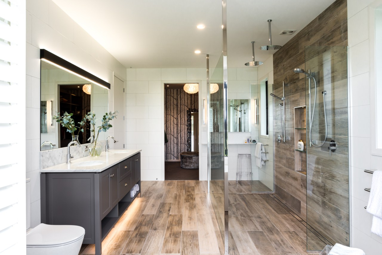​​​​​​​A dressing room accessed by both the master bathroom, building, ceiling, door, estate, floor, flooring, furniture, hardwood, home, house, interior design, loft, property, real estate, room, tile, wood flooring, white, gray